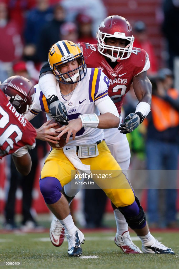 <a gi-track='captionPersonalityLinkClicked' href=/galleries/search?phrase=Zach+Mettenberger&family=editorial&specificpeople=6548476 ng-click='$event.stopPropagation()'>Zach Mettenberger</a> #8 of the LSU Tigers is sacked by Chris Smith #42 of the Arkansas Razorbacks at Razorback Stadium on November 23, 2012 in Fayetteville, Arkansas. The Tigers defeated the Razorbacks 20-13.