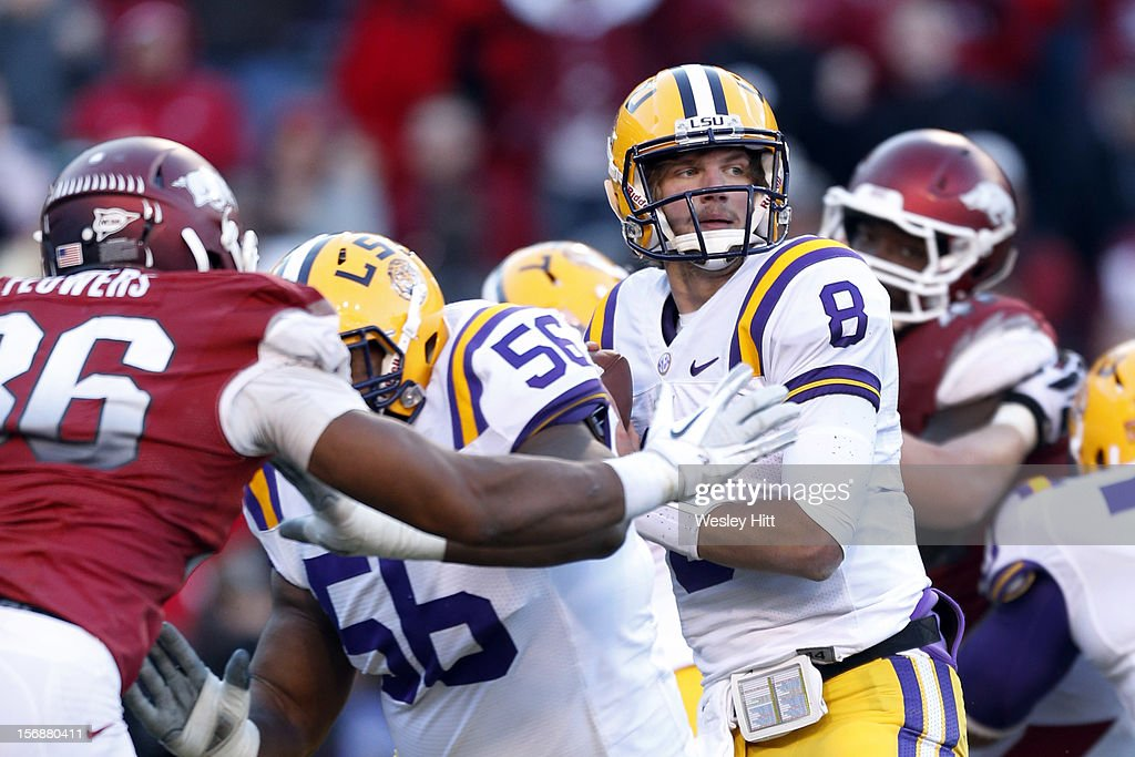 <a gi-track='captionPersonalityLinkClicked' href=/galleries/search?phrase=Zach+Mettenberger&family=editorial&specificpeople=6548476 ng-click='$event.stopPropagation()'>Zach Mettenberger</a> #8 of the LSU Tigers looks downfield for a receiver during a game against the Arkansas Razorbacks at Razorback Stadium on November 23, 2012 in Fayetteville, Arkansas. The Tigers defeated the Razorbacks 20-13.