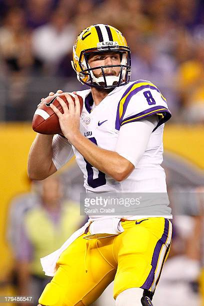 Zach Mettenberger of the LSU Tigers looks to pass during a game against the TCU Horned Frogs at Cowboys Stadium on August 31 2013 in Arlington Texas