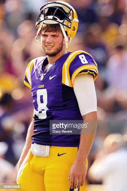 Zach Mettenberger of the LSU Tigers participates in pregame warmups prior to a game against the Kent State Golden Flashes at Tiger Stadium on...