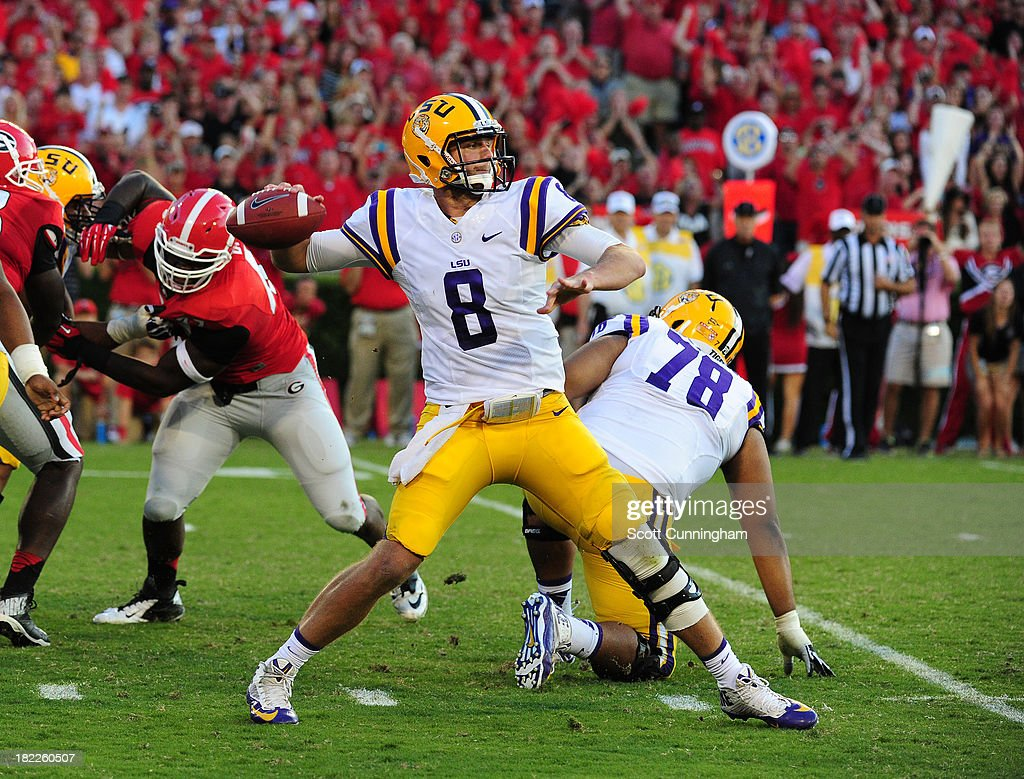 <a gi-track='captionPersonalityLinkClicked' href=/galleries/search?phrase=Zach+Mettenberger&family=editorial&specificpeople=6548476 ng-click='$event.stopPropagation()'>Zach Mettenberger</a> #8 of the LSU Tigers passes against the Georgia Bulldogs at Sanford Stadium on September 28, 2013 in Athens, Georgia.