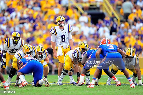 Zach Mettenberger of the LSU Tigers prepares for a play against the Florida Gators during a game at Tiger Stadium on October 12 2013 in Baton Rouge...