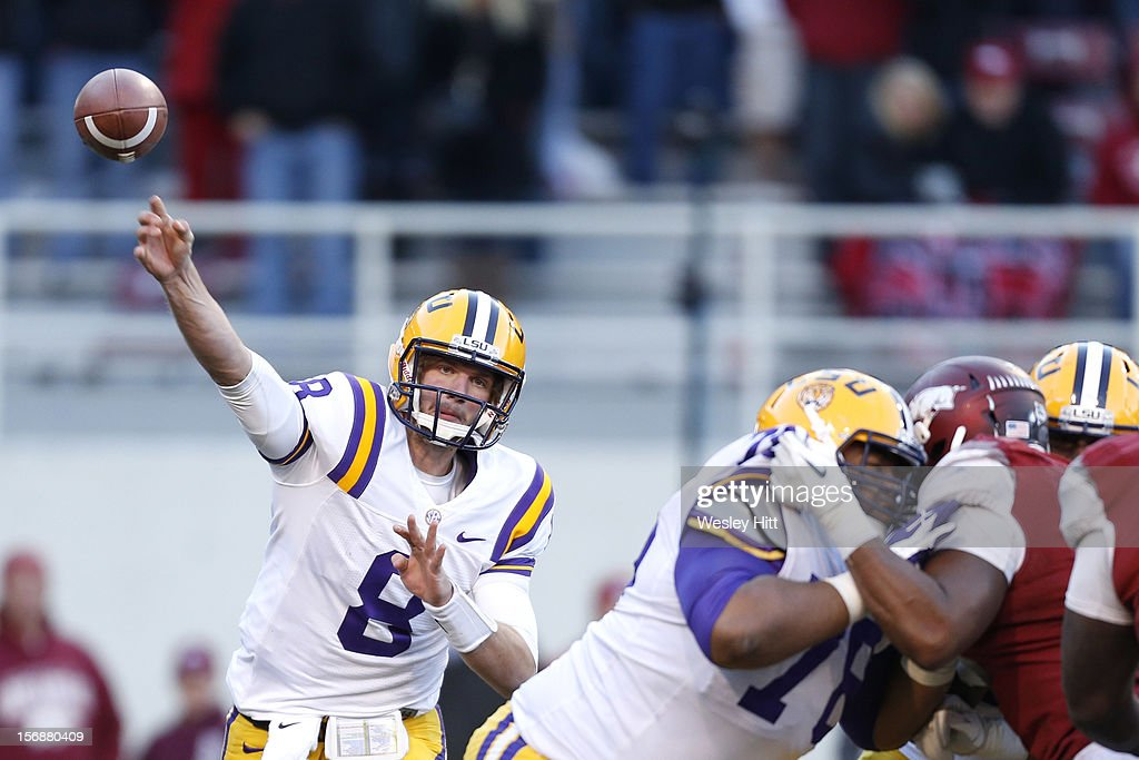 <a gi-track='captionPersonalityLinkClicked' href=/galleries/search?phrase=Zach+Mettenberger&family=editorial&specificpeople=6548476 ng-click='$event.stopPropagation()'>Zach Mettenberger</a> #8 of the LSU Tigers throws a pass against the Arkansas Razorbacks at Razorback Stadium on November 23, 2012 in Fayetteville, Arkansas. The Tigers defeated the Razorbacks 20-13.