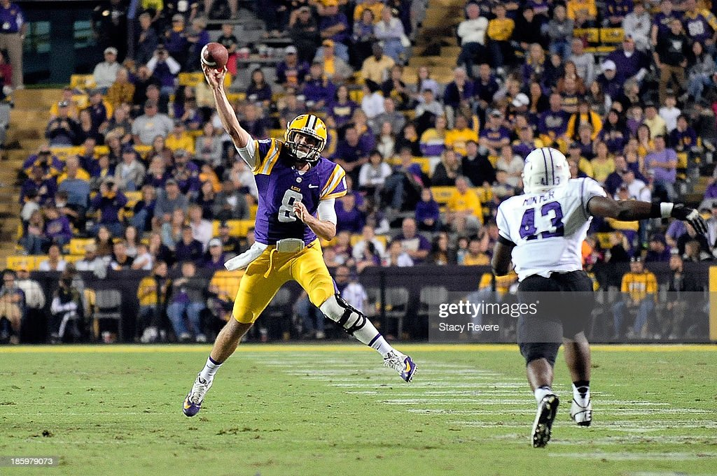 <a gi-track='captionPersonalityLinkClicked' href=/galleries/search?phrase=Zach+Mettenberger&family=editorial&specificpeople=6548476 ng-click='$event.stopPropagation()'>Zach Mettenberger</a> #8 of the LSU Tigers throws a pass against the Furman Paladins during a game at Tiger Stadium on October 26, 2013 in Baton Rouge, Louisiana. LSU won the game 48-16.