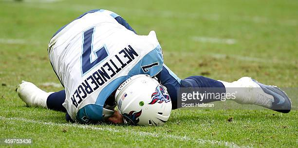 Zach Mettenberger of the Tennessee Titans lies on the filed injured against the Houston Texans in the third quarter in a NFL game on November 30 2014...
