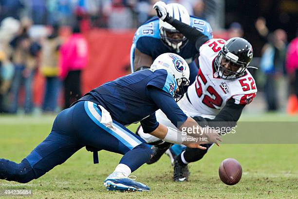 Zach Mettenberger of the Tennessee Titans recovers his own fumble against Justin Durant of the Atlanta Falcons at Nissan Stadium on October 25 2015...