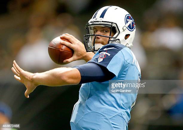 Zach Mettenberger of the Tennessee Titans warms up during a preseason game against the New Orleans Saints at the MercedesBenz Superdome on August 15...
