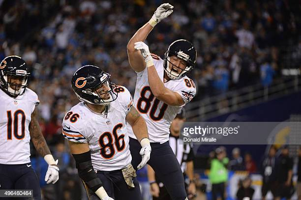 Zach Miller of the Chicago Bears celebrates a touchdown reception against the San Diego Chargers with teammate Marc Mariani of the Chicago Bears at...