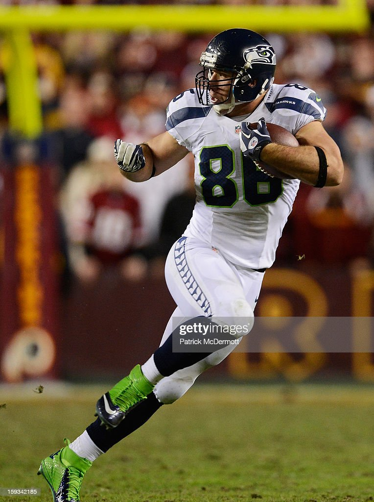 Zach Miller #86 of the Seattle Seahawks carries the ball against the Washington Redskins during the NFC Wild Card Playoff Game at FedExField on January 6, 2013 in Landover, Maryland.