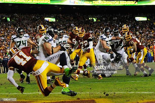 Zach Miller of the Seattle Seahawks scores on a two point conversion play against the defense of Madieu Williams of the Washington Redskins in the...