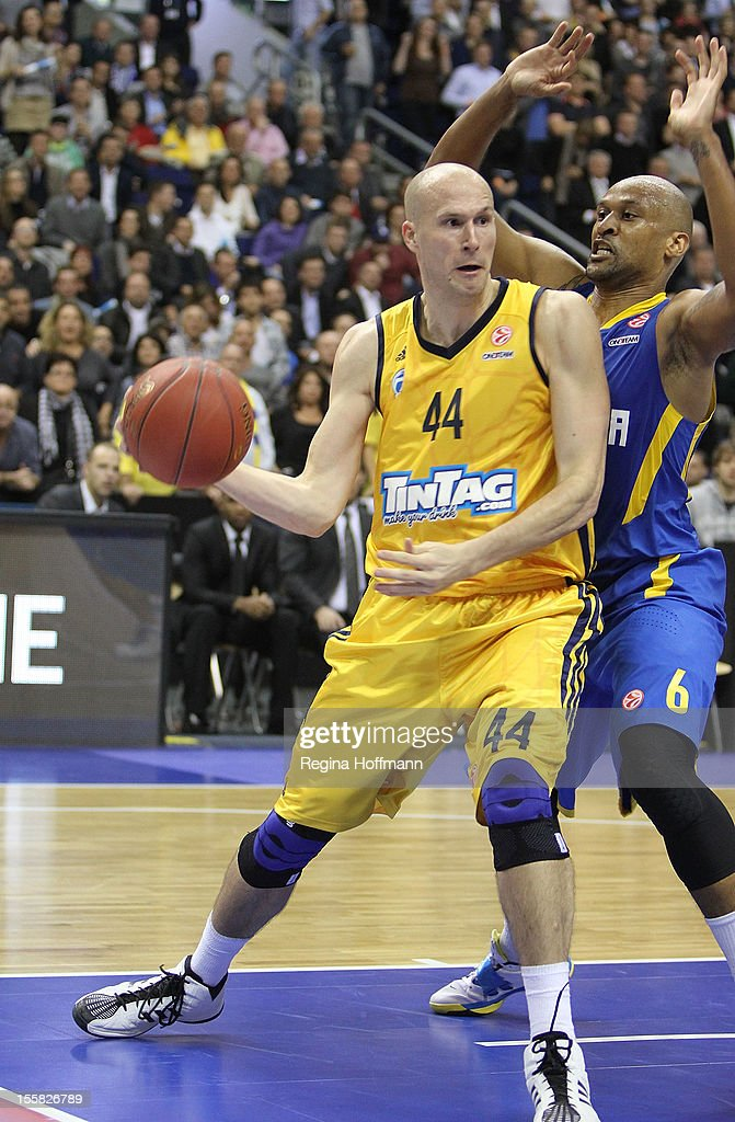 <a gi-track='captionPersonalityLinkClicked' href=/galleries/search?phrase=Zach+Morley&family=editorial&specificpeople=213554 ng-click='$event.stopPropagation()'>Zach Morley</a>, #44 of Alba Berlin competes with Devin Smith, #6 of Maccabi Electra Tel Aviv during the 2012-2013 Turkish Airlines Euroleague Regular Season Game Day 5 between Alba Berlin v Maccabi Electra Tel Aviv at O2 World on November 8, 2012 in Berlin, Germany.