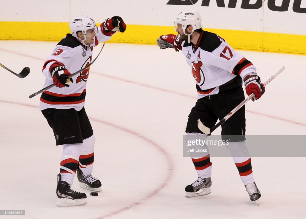 <a gi-track='captionPersonalityLinkClicked' href=/galleries/search?phrase=Zach+Parise&family=editorial&specificpeople=213606 ng-click='$event.stopPropagation()'>Zach Parise</a> #9 and <a gi-track='captionPersonalityLinkClicked' href=/galleries/search?phrase=Ilya+Kovalchuk&family=editorial&specificpeople=201796 ng-click='$event.stopPropagation()'>Ilya Kovalchuk</a> #17 of the New Jersey Devils celebrate Kovalchuk's third period empty net goal over the Los Angeles Kings in Game Four of the 2012 Stanley Cup Final at Staples Center on June 6, 2012 in Los Angeles, California.