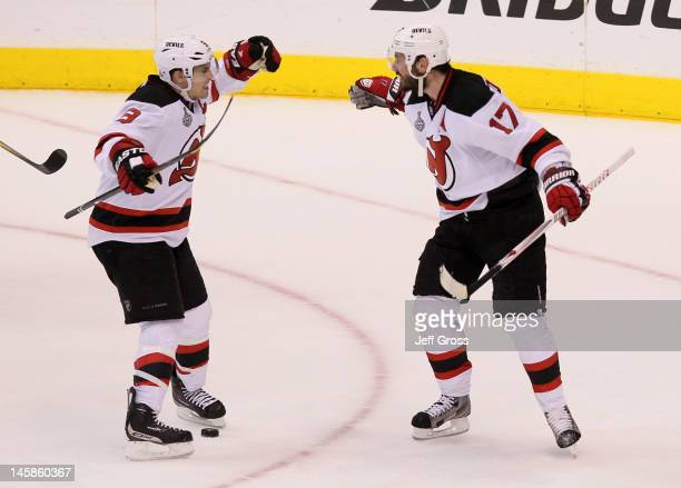 Zach Parise and Ilya Kovalchuk of the New Jersey Devils celebrate Kovalchuk's third period empty net goal over the Los Angeles Kings in Game Four of...