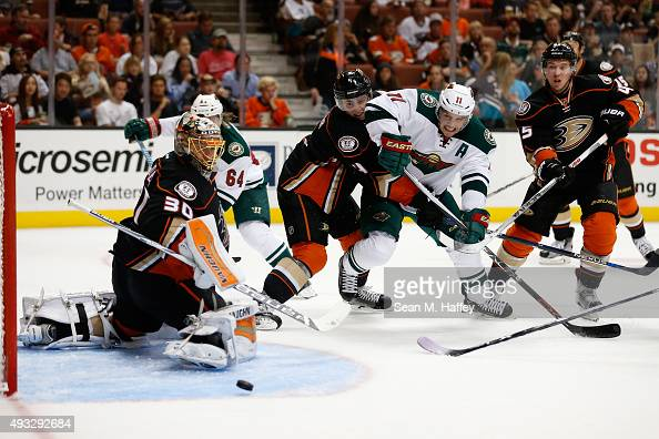 Zach Parise and Mikael Granlund of the Minnesota Wild crash the net as Anton Khudobin of the Anaheim Ducks Sami Vatanen of the Anaheim Ducks and Cam...