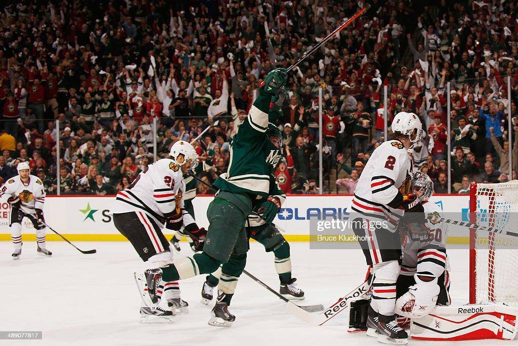<a gi-track='captionPersonalityLinkClicked' href=/galleries/search?phrase=Zach+Parise&family=editorial&specificpeople=213606 ng-click='$event.stopPropagation()'>Zach Parise</a> #11 celebrates after his Minnesota Wild teammate <a gi-track='captionPersonalityLinkClicked' href=/galleries/search?phrase=Jared+Spurgeon&family=editorial&specificpeople=4594192 ng-click='$event.stopPropagation()'>Jared Spurgeon</a> #46 scores a goal against the Chicago Blackhawks Game Four of the Second Round of the 2014 Stanley Cup Playoffs on May 9, 2014 at the Xcel Energy Center in St. Paul, Minnesota.