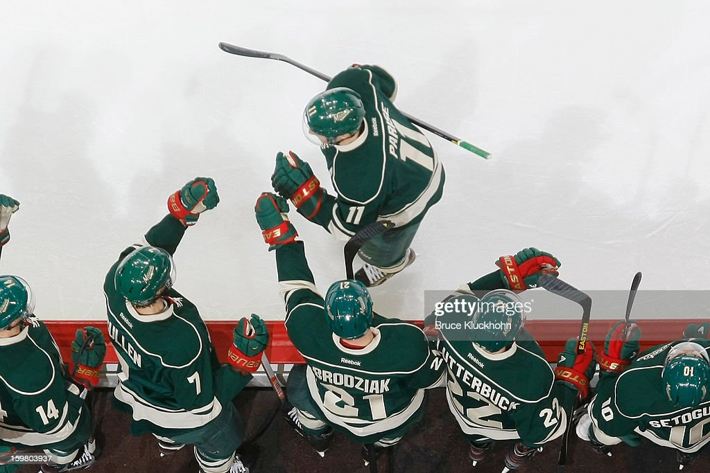 <a gi-track='captionPersonalityLinkClicked' href=/galleries/search?phrase=Zach+Parise&family=editorial&specificpeople=213606 ng-click='$event.stopPropagation()'>Zach Parise</a> #11 is congratulated by his teammates after scoring his first goal as a member of the Minnesota Wild against the Dallas Stars during the game on January 20, 2013 at the Xcel Energy Center in Saint Paul, Minnesota.