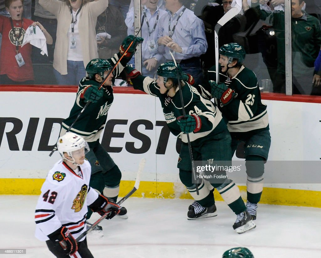 <a gi-track='captionPersonalityLinkClicked' href=/galleries/search?phrase=Zach+Parise&family=editorial&specificpeople=213606 ng-click='$event.stopPropagation()'>Zach Parise</a> #11, <a gi-track='captionPersonalityLinkClicked' href=/galleries/search?phrase=Mikael+Granlund&family=editorial&specificpeople=5649678 ng-click='$event.stopPropagation()'>Mikael Granlund</a> #64 and <a gi-track='captionPersonalityLinkClicked' href=/galleries/search?phrase=Jonas+Brodin&family=editorial&specificpeople=7832272 ng-click='$event.stopPropagation()'>Jonas Brodin</a> #25 of the Minnesota Wild celebrate a goal by Granlund as Joakim Nordstrom #42 of the Chicago Blackhawks looks on during the third period in Game Three of the Second Round of the 2014 NHL Stanley Cup Playoffs on May 6, 2014 at Xcel Energy Center in St Paul, Minnesota. The Wild defeated the Blackhawks 4-0.