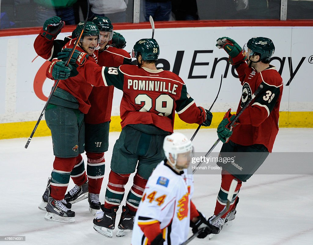 <a gi-track='captionPersonalityLinkClicked' href=/galleries/search?phrase=Zach+Parise&family=editorial&specificpeople=213606 ng-click='$event.stopPropagation()'>Zach Parise</a> #11, <a gi-track='captionPersonalityLinkClicked' href=/galleries/search?phrase=Mikael+Granlund&family=editorial&specificpeople=5649678 ng-click='$event.stopPropagation()'>Mikael Granlund</a> #64, <a gi-track='captionPersonalityLinkClicked' href=/galleries/search?phrase=Jason+Pominville&family=editorial&specificpeople=570525 ng-click='$event.stopPropagation()'>Jason Pominville</a> #29, and <a gi-track='captionPersonalityLinkClicked' href=/galleries/search?phrase=Nate+Prosser&family=editorial&specificpeople=6851127 ng-click='$event.stopPropagation()'>Nate Prosser</a> #39 of the Minnesota Wild celebrate a goal by Parise as Chris Butler #44 of the Calgary Flames returns to the bench during the third period of the game on March 3, 2014 at Xcel Energy Center in St Paul, Minnesota. The Wild defeated the Flames 3-2.
