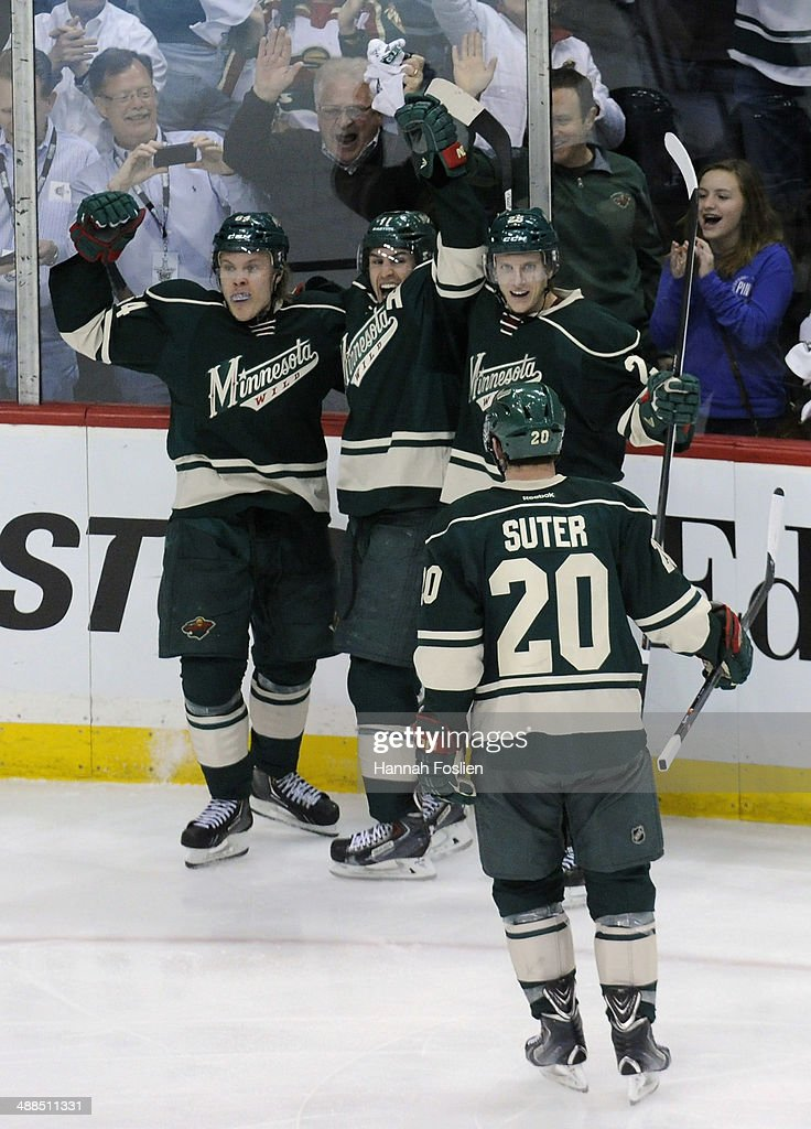 <a gi-track='captionPersonalityLinkClicked' href=/galleries/search?phrase=Zach+Parise&family=editorial&specificpeople=213606 ng-click='$event.stopPropagation()'>Zach Parise</a> #11, <a gi-track='captionPersonalityLinkClicked' href=/galleries/search?phrase=Mikael+Granlund&family=editorial&specificpeople=5649678 ng-click='$event.stopPropagation()'>Mikael Granlund</a> #64, <a gi-track='captionPersonalityLinkClicked' href=/galleries/search?phrase=Jonas+Brodin&family=editorial&specificpeople=7832272 ng-click='$event.stopPropagation()'>Jonas Brodin</a> #25 and <a gi-track='captionPersonalityLinkClicked' href=/galleries/search?phrase=Ryan+Suter&family=editorial&specificpeople=583306 ng-click='$event.stopPropagation()'>Ryan Suter</a> #20 of the Minnesota Wild celebrate a goal by Granlund against the Chicago Blackhawks during the third period in Game Three of the Second Round of the 2014 NHL Stanley Cup Playoffs on May 6, 2014 at Xcel Energy Center in St Paul, Minnesota. The Wild defeated the Blackhawks 4-0.