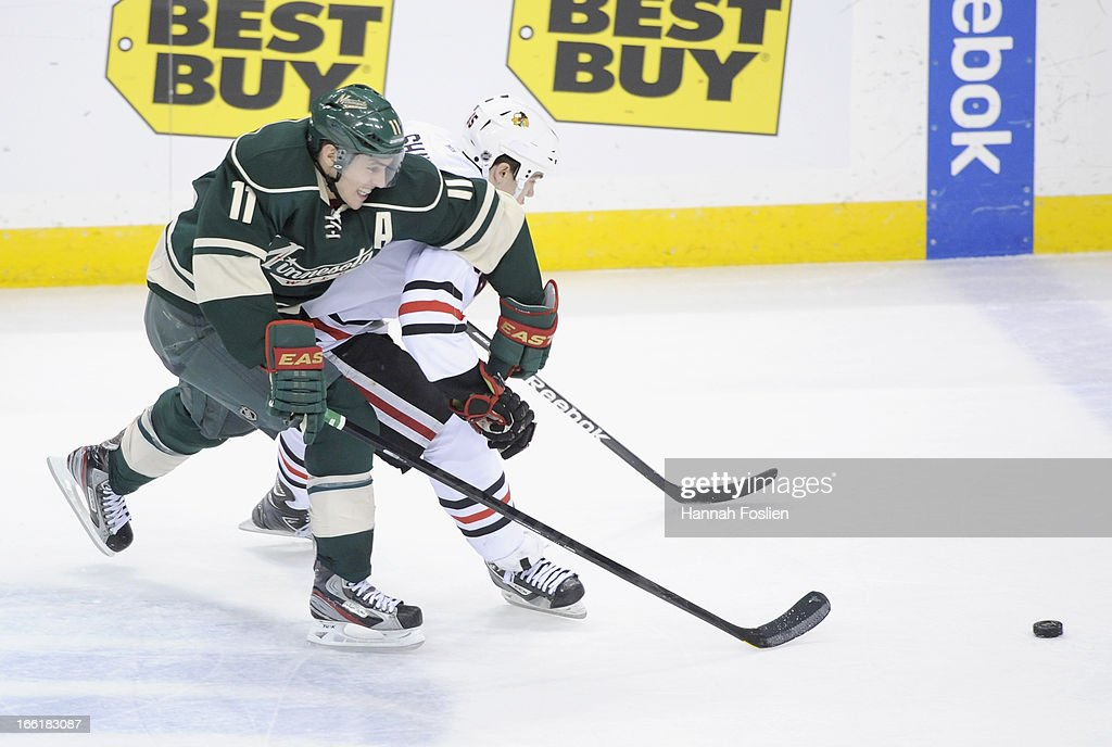 <a gi-track='captionPersonalityLinkClicked' href=/galleries/search?phrase=Zach+Parise&family=editorial&specificpeople=213606 ng-click='$event.stopPropagation()'>Zach Parise</a> #11 of the Minnesota Wild and Andrew Shaw #65 of the Chicago Blackhawks go after the puck during the third period of the game on April 9, 2013 at Xcel Energy Center in St Paul, Minnesota. Parise was called for tripping on the play. The Blackhawks defeated the Wild 1-0.