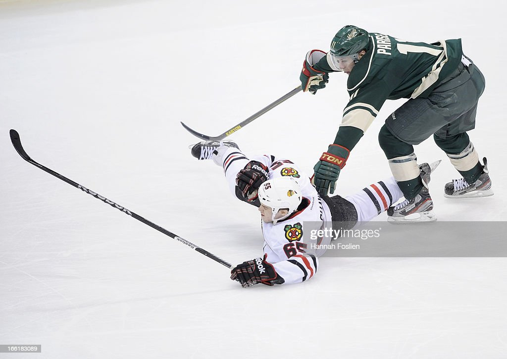 <a gi-track='captionPersonalityLinkClicked' href=/galleries/search?phrase=Zach+Parise&family=editorial&specificpeople=213606 ng-click='$event.stopPropagation()'>Zach Parise</a> #11 of the Minnesota Wild and Andrew Shaw #65 of the Chicago Blackhawks fall to the ice during the third period of the game on April 9, 2013 at Xcel Energy Center in St Paul, Minnesota. Parise was called for tripping on the play. The Blackhawks defeated the Wild 1-0.