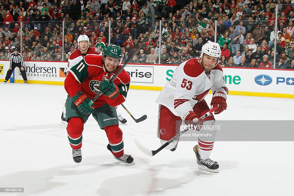 <a gi-track='captionPersonalityLinkClicked' href=/galleries/search?phrase=Zach+Parise&family=editorial&specificpeople=213606 ng-click='$event.stopPropagation()'>Zach Parise</a> #11 of the Minnesota Wild and <a gi-track='captionPersonalityLinkClicked' href=/galleries/search?phrase=Derek+Morris&family=editorial&specificpeople=204188 ng-click='$event.stopPropagation()'>Derek Morris</a> #53 of the Phoenix Coyotes skate to the puck during the game on March 27, 2013 at the Xcel Energy Center in Saint Paul, Minnesota.
