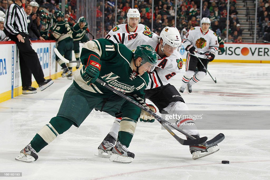 <a gi-track='captionPersonalityLinkClicked' href=/galleries/search?phrase=Zach+Parise&family=editorial&specificpeople=213606 ng-click='$event.stopPropagation()'>Zach Parise</a> #11 of the Minnesota Wild and <a gi-track='captionPersonalityLinkClicked' href=/galleries/search?phrase=Duncan+Keith&family=editorial&specificpeople=4194433 ng-click='$event.stopPropagation()'>Duncan Keith</a> #2 of the Chicago Blackhawks battle for the puck during the game on April 9, 2013 at the Xcel Energy Center in Saint Paul, Minnesota.