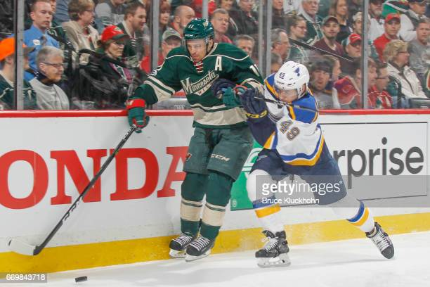 Zach Parise of the Minnesota Wild and Ivan Barbashev of the St Louis Blues battle for the puck in Game One of the Western Conference First Round...