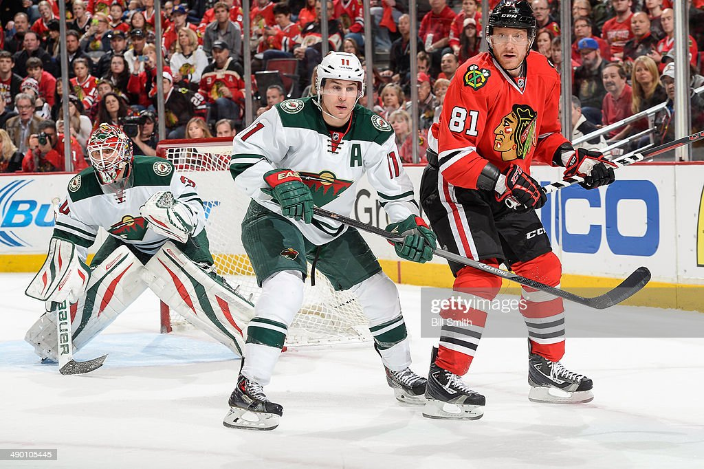 Zach Parise #11 of the Minnesota Wild and Marian Hossa #81 of the Chicago Blackhawks stand next to goalie Ilya Bryzgalov #30 of the Wild in Game Two of the Second Round of the 2014 Stanley Cup Playoffs at the United Center on May 04, 2014 in Chicago, Illinois.