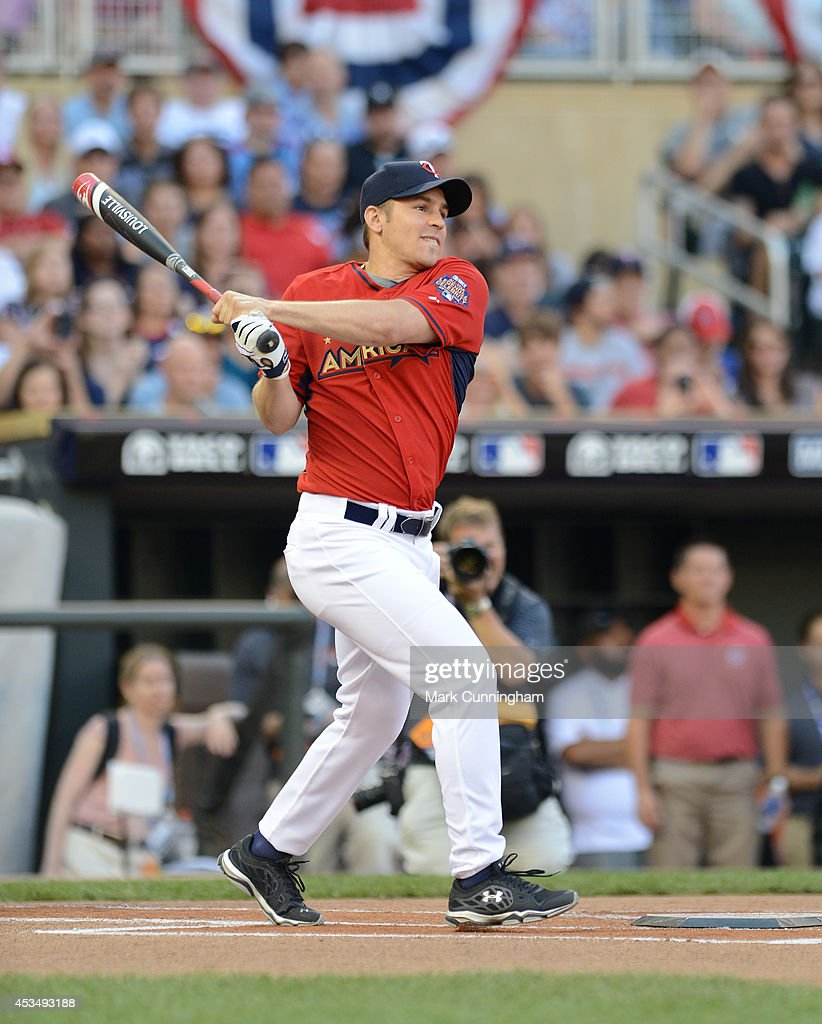 Zach Parise of the Minnesota Wild bats during the 2014 Taco Bell MLB All-Star Legends & Celebrity Softball Game at Target Field on July 13, 2014 in Minneapolis, Minnesota.