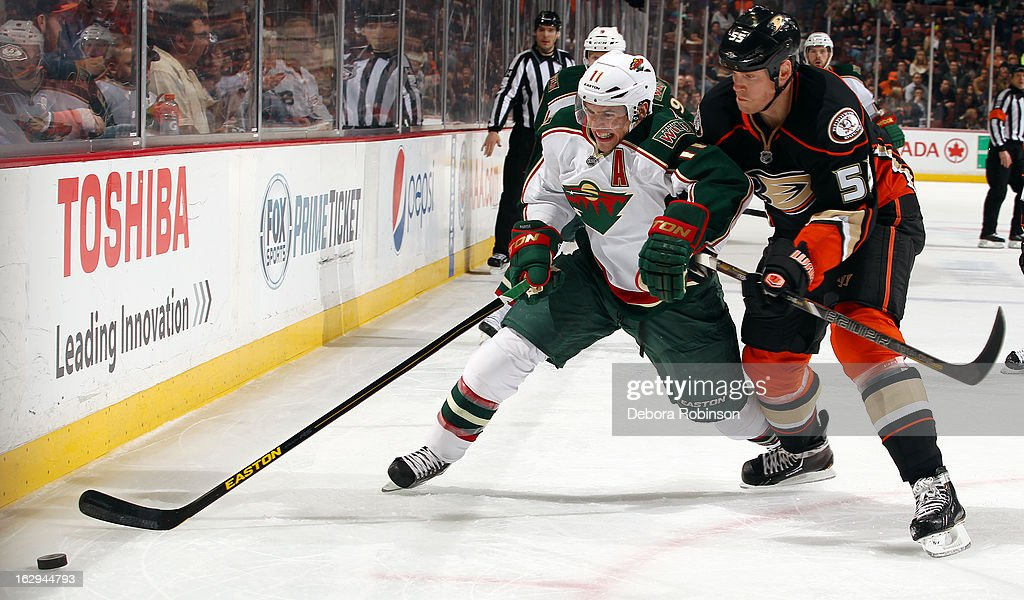 <a gi-track='captionPersonalityLinkClicked' href=/galleries/search?phrase=Zach+Parise&family=editorial&specificpeople=213606 ng-click='$event.stopPropagation()'>Zach Parise</a> #11 of the Minnesota Wild battles for the puck against <a gi-track='captionPersonalityLinkClicked' href=/galleries/search?phrase=Bryan+Allen+-+Ice+Hockey+Player&family=editorial&specificpeople=206454 ng-click='$event.stopPropagation()'>Bryan Allen</a> #55 of the Anaheim Ducks on March 1, 2013 at Honda Center in Anaheim, California.