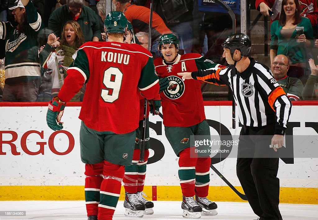 <a gi-track='captionPersonalityLinkClicked' href=/galleries/search?phrase=Zach+Parise&family=editorial&specificpeople=213606 ng-click='$event.stopPropagation()'>Zach Parise</a> #11 of the Minnesota Wild celebrates a goal with teammates Mikko Koivu #9 and Charlie Coyle #3 against the Florida Panthers during the game on November 15, 2013 at the Xcel Energy Center in St. Paul, Minnesota.