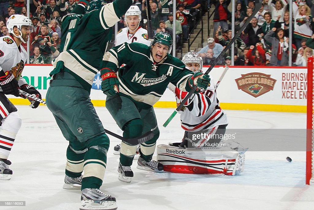 <a gi-track='captionPersonalityLinkClicked' href=/galleries/search?phrase=Zach+Parise&family=editorial&specificpeople=213606 ng-click='$event.stopPropagation()'>Zach Parise</a> #11 of the Minnesota Wild celebrates after scoring a goal against the Chicago Blackhawks in Game Three of the Western Conference Quarterfinals during the 2013 NHL Stanley Cup Playoffs on May 5, 2013 at the Xcel Energy Center in St. Paul, Minnesota.