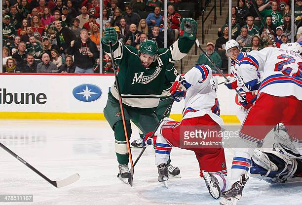 Zach Parise of the Minnesota Wild celebrates after scoring the gamewinning goal against the New York Rangers during the game on March 13 2014 at the...