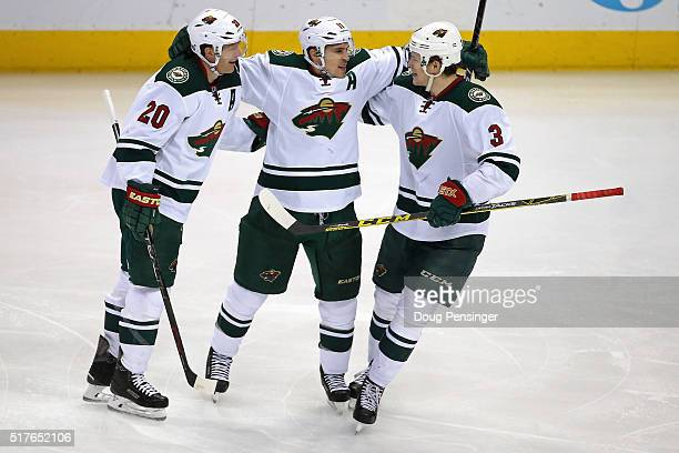 Zach Parise of the Minnesota Wild celebrates his goal against the Colorado Avalanche to take a 30 lead in the third period with teammates Ryan Suter...