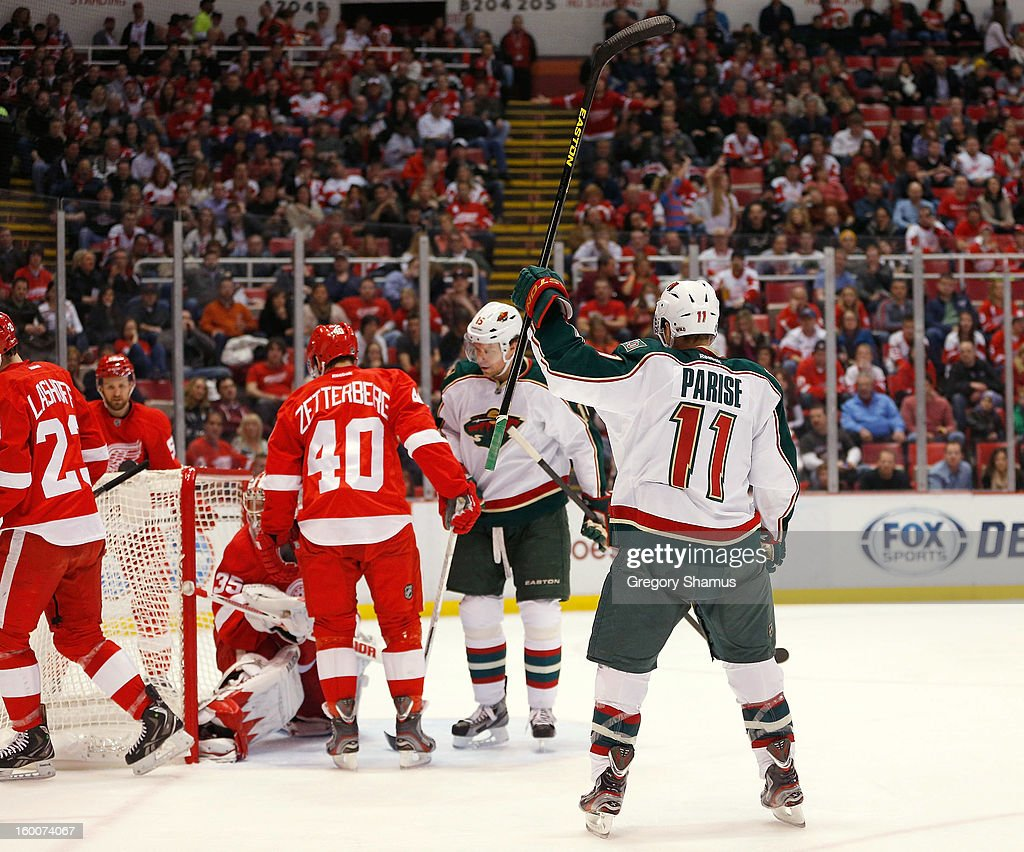 <a gi-track='captionPersonalityLinkClicked' href=/galleries/search?phrase=Zach+Parise&family=editorial&specificpeople=213606 ng-click='$event.stopPropagation()'>Zach Parise</a> #11 of the Minnesota Wild celebrates his third period goal while playing the Detroit Red Wings at Joe Louis Arena on January 25, 2013 in Detroit, Michigan.