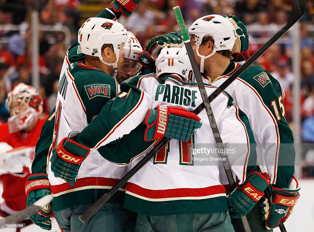 <a gi-track='captionPersonalityLinkClicked' href=/galleries/search?phrase=Zach+Parise&family=editorial&specificpeople=213606 ng-click='$event.stopPropagation()'>Zach Parise</a> #11 of the Minnesota Wild celebrates his third period goal with <a gi-track='captionPersonalityLinkClicked' href=/galleries/search?phrase=Dany+Heatley&family=editorial&specificpeople=202142 ng-click='$event.stopPropagation()'>Dany Heatley</a> #15 and <a gi-track='captionPersonalityLinkClicked' href=/galleries/search?phrase=Mikko+Koivu&family=editorial&specificpeople=584987 ng-click='$event.stopPropagation()'>Mikko Koivu</a> #9 while playing the Detroit Red Wings at Joe Louis Arena on January 25, 2013 in Detroit, Michigan. Detroit won the game 5-3.