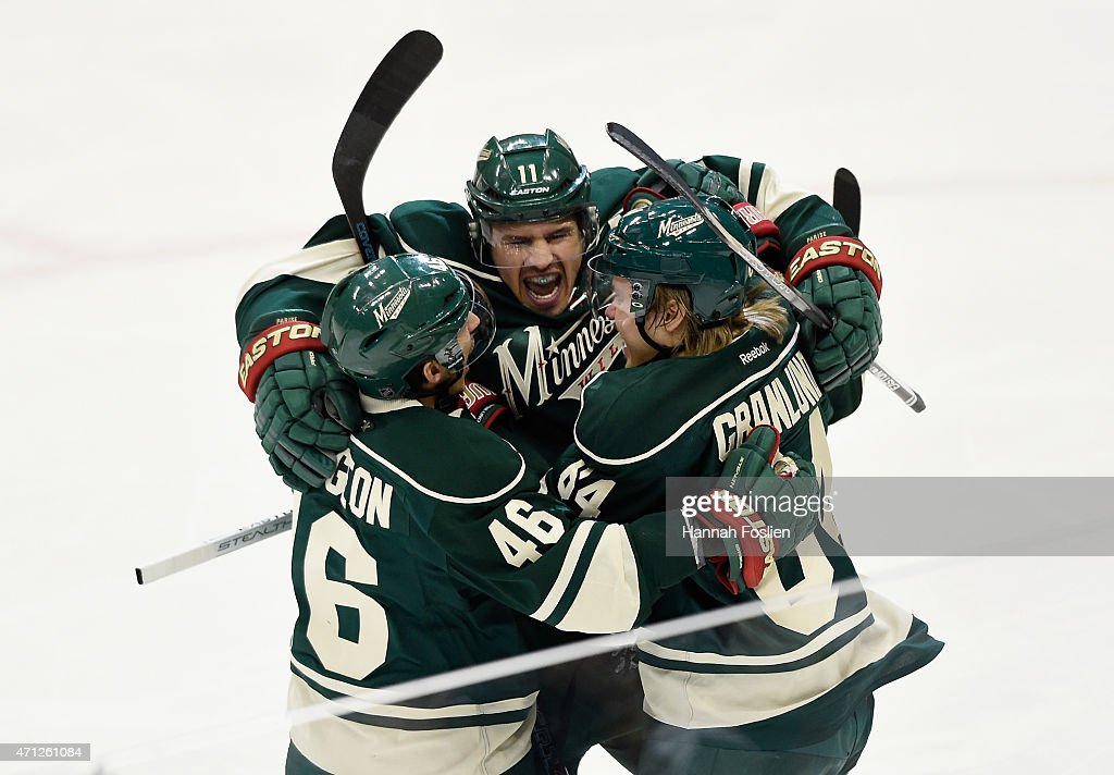 <a gi-track='captionPersonalityLinkClicked' href=/galleries/search?phrase=Zach+Parise&family=editorial&specificpeople=213606 ng-click='$event.stopPropagation()'>Zach Parise</a> #11 of the Minnesota Wild celebrates scoring a short-handed goal against the St. Louis Blues with teammate <a gi-track='captionPersonalityLinkClicked' href=/galleries/search?phrase=Jared+Spurgeon&family=editorial&specificpeople=4594192 ng-click='$event.stopPropagation()'>Jared Spurgeon</a> #46 and <a gi-track='captionPersonalityLinkClicked' href=/galleries/search?phrase=Mikael+Granlund&family=editorial&specificpeople=5649678 ng-click='$event.stopPropagation()'>Mikael Granlund</a> #64 during the first period in Game Six of the Western Conference Quarterfinals during the 2015 NHL Stanley Cup Playoffs on April 26, 2015 at Xcel Energy Center in St Paul, Minnesota.