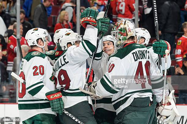 Zach Parise of the Minnesota Wild celebrates with teammates after the Wild defeated the Chicago Blackhawks 21 during the NHL game at the United...