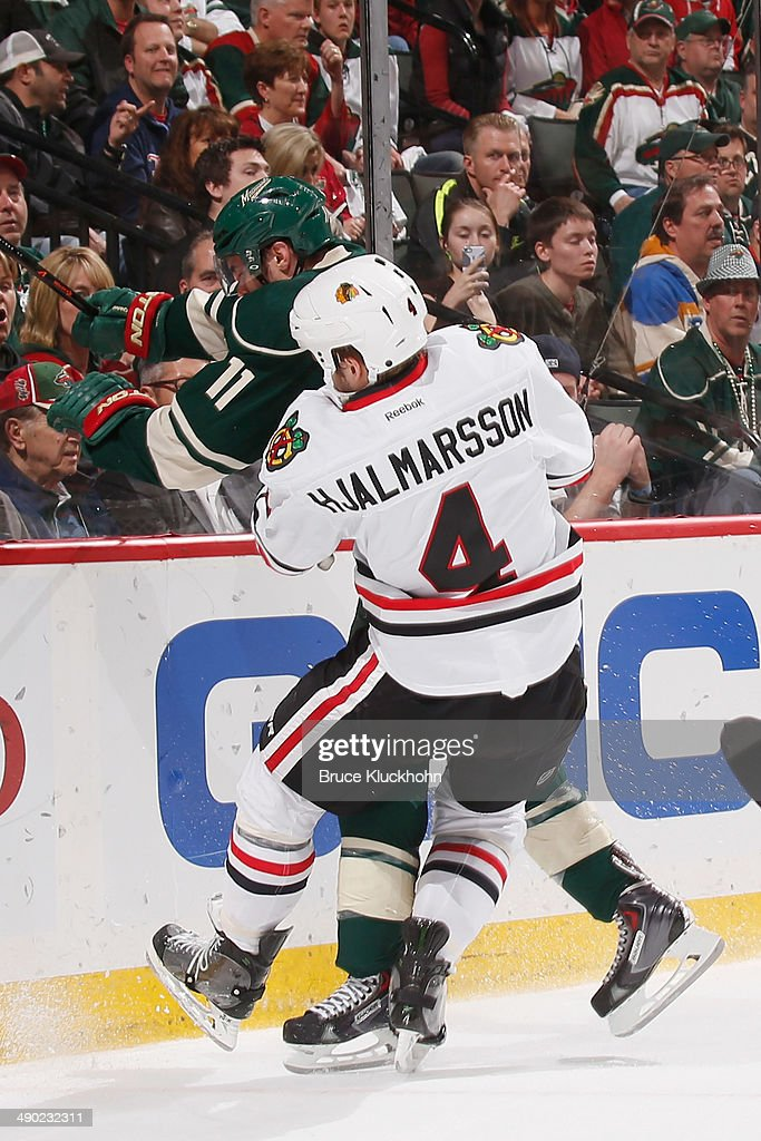 Zach Parise #11 of the Minnesota Wild checks Niklas Hjalmarsson #4 of the Chicago Blackhawks during Game Six of the Second Round of the 2014 Stanley Cup Playoffs on May 13, 2014 at the Xcel Energy Center in St. Paul, Minnesota.
