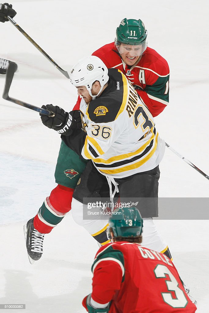 <a gi-track='captionPersonalityLinkClicked' href=/galleries/search?phrase=Zach+Parise&family=editorial&specificpeople=213606 ng-click='$event.stopPropagation()'>Zach Parise</a> #11 of the Minnesota Wild checks <a gi-track='captionPersonalityLinkClicked' href=/galleries/search?phrase=Zac+Rinaldo&family=editorial&specificpeople=4129574 ng-click='$event.stopPropagation()'>Zac Rinaldo</a> #36 of the Boston Bruins during the game on February 13, 2016 at the Xcel Energy Center in St. Paul, Minnesota.