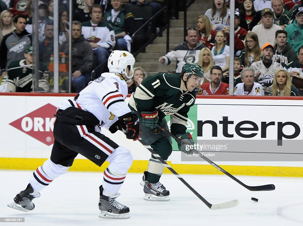 Zach Parise #11 of the Minnesota Wild controls the puck against Niklas Hjalmarsson #4 of the Chicago Blackhawks during the second period in Game Three of the Second Round of the 2014 NHL Stanley Cup Playoffs on May 6, 2014 at Xcel Energy Center in St Paul, Minnesota.