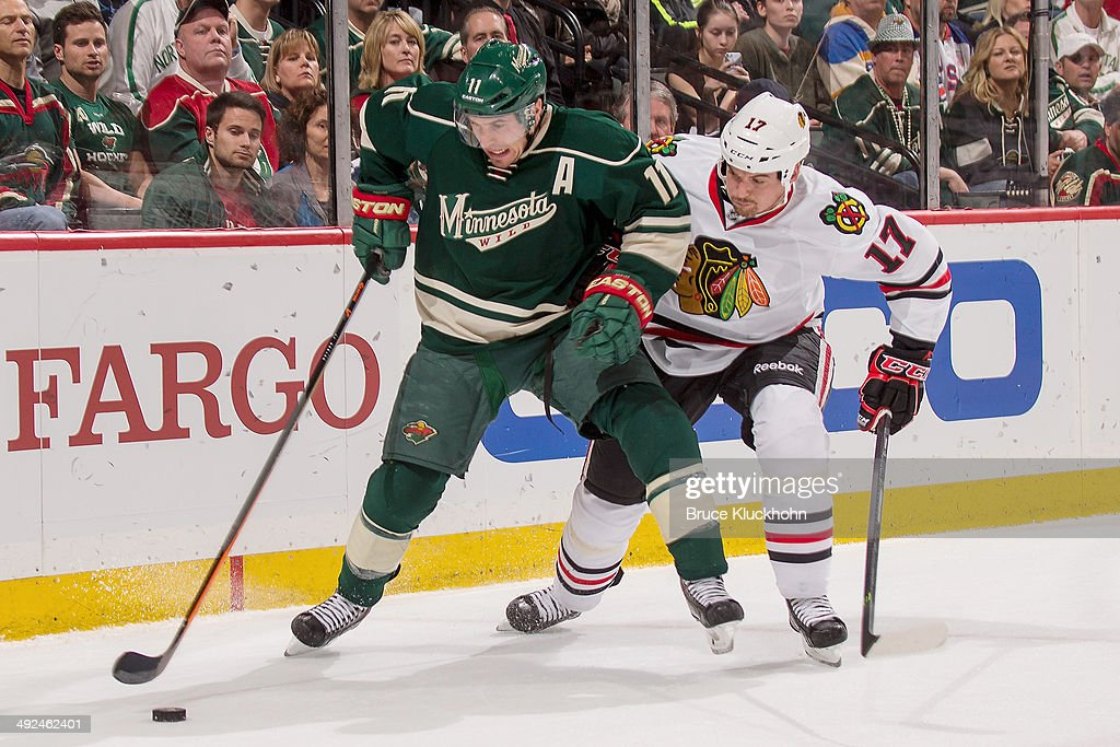 Zach Parise #11 of the Minnesota Wild controls the puck with Sheldon Brookbank #17 of the Chicago Blackhawks defending during Game Six of the Second Round of the 2014 Stanley Cup Playoffs on May 13, 2014 at the Xcel Energy Center in St. Paul, Minnesota.