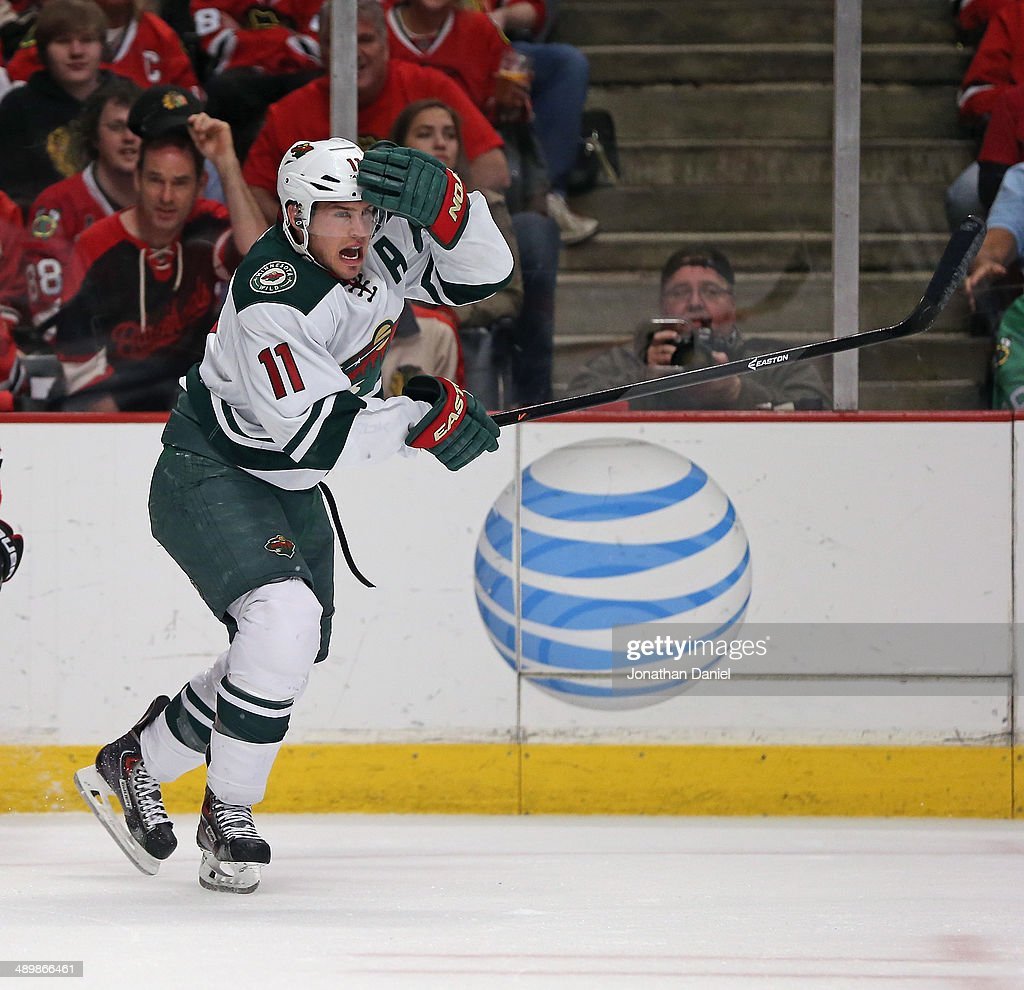 <a gi-track='captionPersonalityLinkClicked' href=/galleries/search?phrase=Zach+Parise&family=editorial&specificpeople=213606 ng-click='$event.stopPropagation()'>Zach Parise</a> #11 of the Minnesota Wild grabs his head after a tangle against the Chicago Blackhawks in Game Five of the Second Round of the 2014 NHL Stanley Cup Playoffs at the United Center on May 11, 2014 in Chicago, Illinois. The Blackhawks defeated the Wild 2-1.