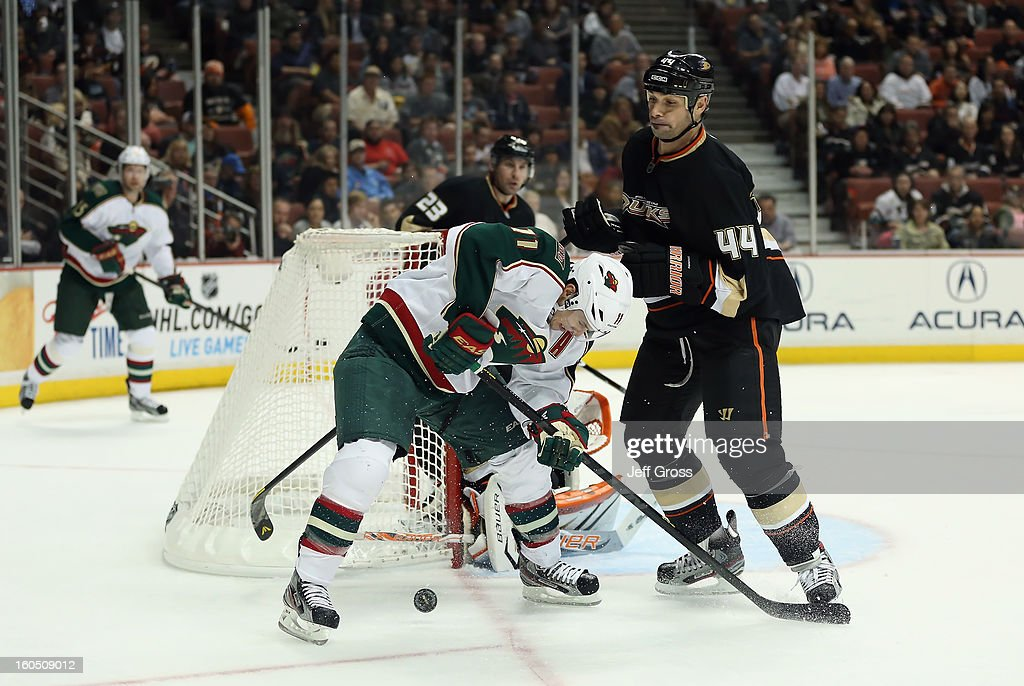 <a gi-track='captionPersonalityLinkClicked' href=/galleries/search?phrase=Zach+Parise&family=editorial&specificpeople=213606 ng-click='$event.stopPropagation()'>Zach Parise</a> #11 of the Minnesota Wild is defended by <a gi-track='captionPersonalityLinkClicked' href=/galleries/search?phrase=Sheldon+Souray&family=editorial&specificpeople=203131 ng-click='$event.stopPropagation()'>Sheldon Souray</a> #44 of the Anaheim Ducks while pursuing the puck in the second period at Honda Center on February 1, 2013 in Anaheim, California. The Ducks defeated the Wild 3-1.