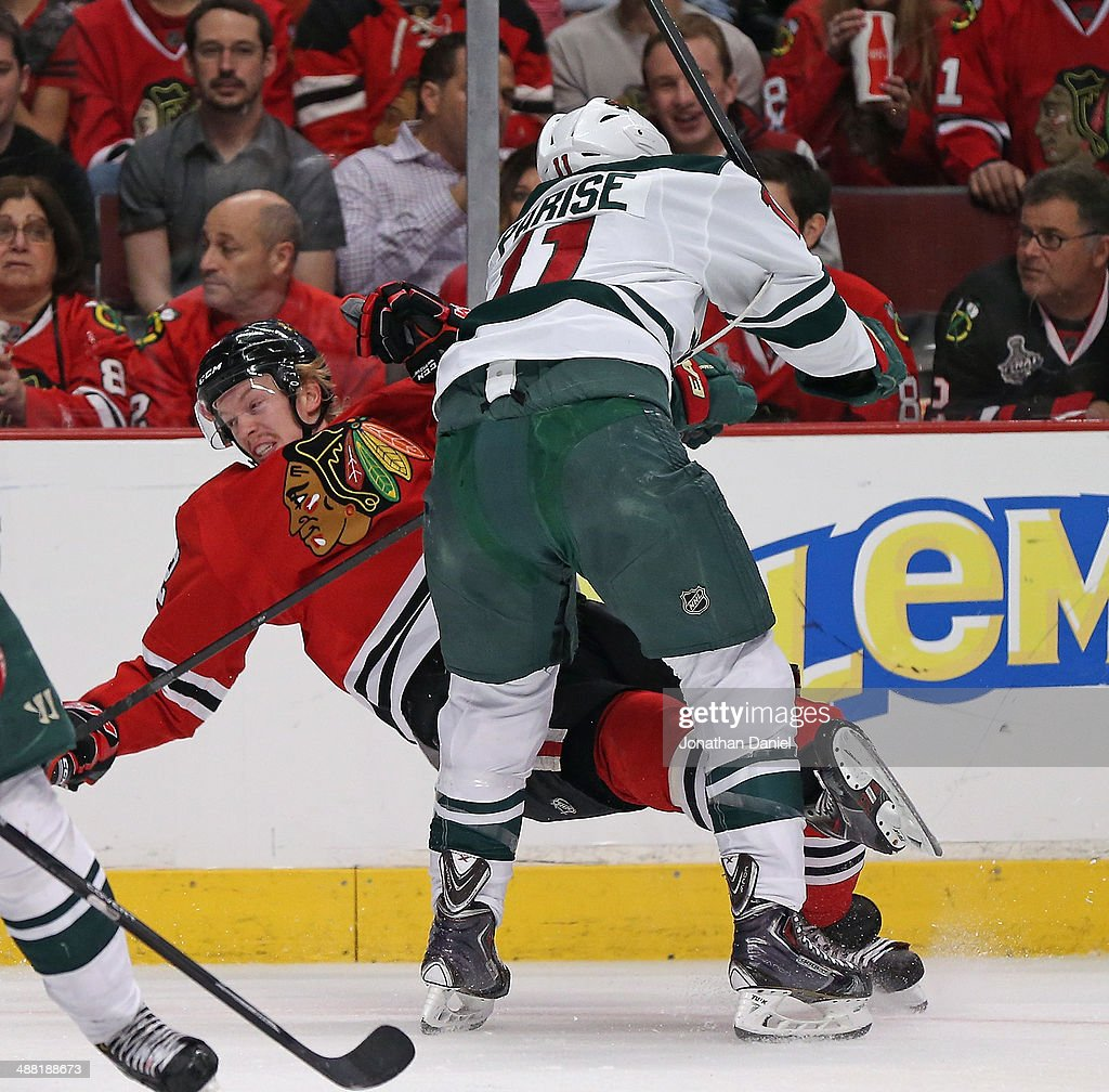 Zach Parise #11 of the Minnesota Wild knocks down Jokaim Nordstrom #42 of the Chicago Blackhawks in Game Two of the Second Round of the 2014 NHL Stanley Cup Playoffs at the United Center on May 4, 2014 in Chicago, Illinois.