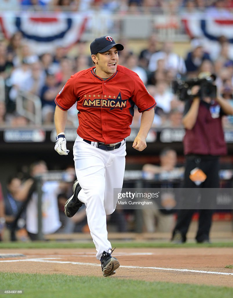 Zach Parise of the Minnesota Wild runs to first base during the 2014 Taco Bell MLB All-Star Legends & Celebrity Softball Game at Target Field on July 13, 2014 in Minneapolis, Minnesota.