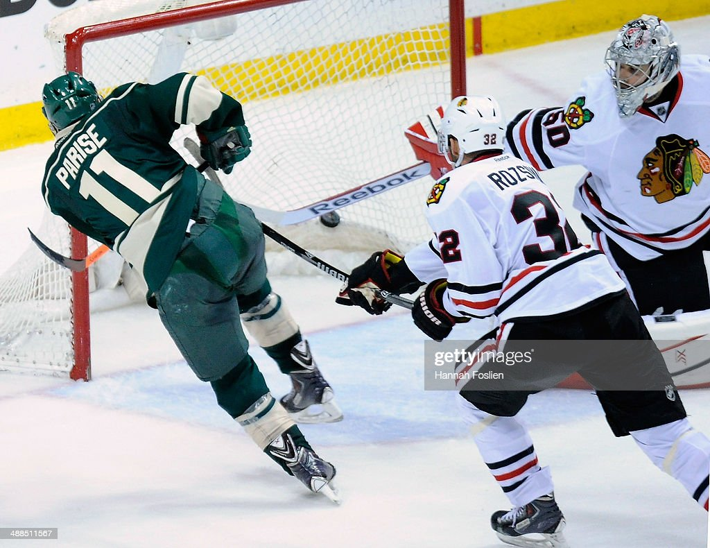 <a gi-track='captionPersonalityLinkClicked' href=/galleries/search?phrase=Zach+Parise&family=editorial&specificpeople=213606 ng-click='$event.stopPropagation()'>Zach Parise</a> #11 of the Minnesota Wild scores a goal against <a gi-track='captionPersonalityLinkClicked' href=/galleries/search?phrase=Corey+Crawford&family=editorial&specificpeople=818935 ng-click='$event.stopPropagation()'>Corey Crawford</a> #50 of the Chicago Blackhawks during the third period in Game Three of the Second Round of the 2014 NHL Stanley Cup Playoffs on May 6, 2014 at Xcel Energy Center in St Paul, Minnesota. The Wild defeated the Blackhawks 4-0.