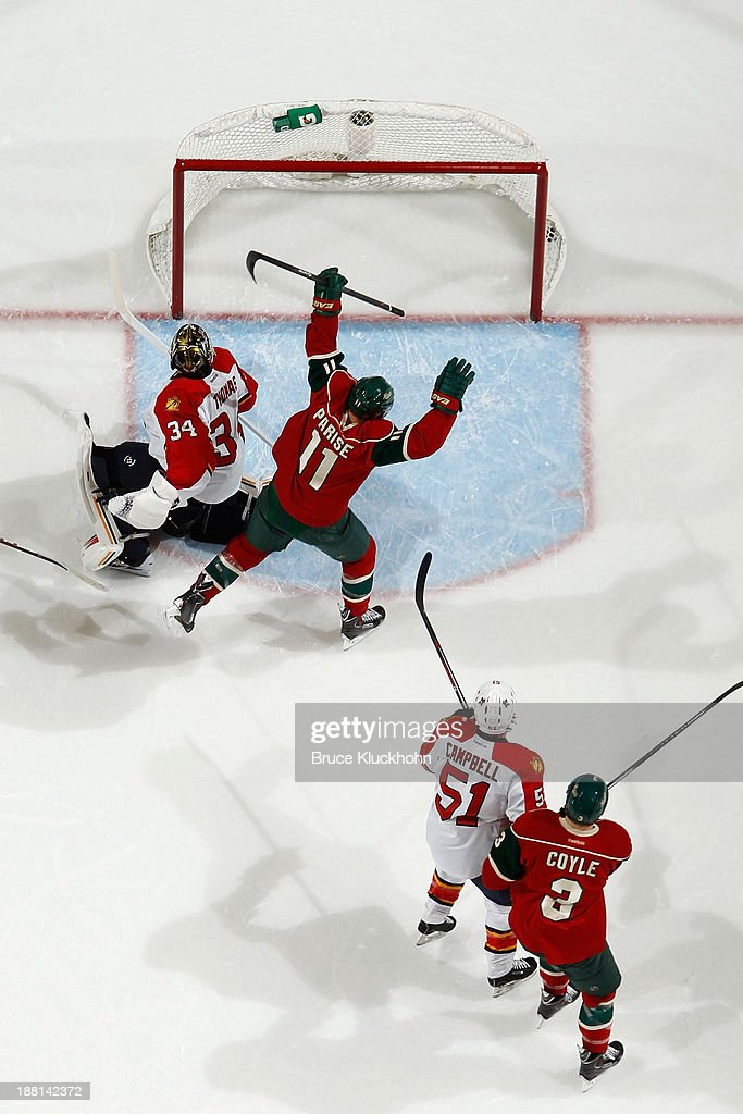 <a gi-track='captionPersonalityLinkClicked' href=/galleries/search?phrase=Zach+Parise&family=editorial&specificpeople=213606 ng-click='$event.stopPropagation()'>Zach Parise</a> #11 of the Minnesota Wild scores a goal in the first period against Tim Thomas #34 of the Florida Panthers as Wild teammate <a gi-track='captionPersonalityLinkClicked' href=/galleries/search?phrase=Charlie+Coyle&family=editorial&specificpeople=7029381 ng-click='$event.stopPropagation()'>Charlie Coyle</a> #3 and <a gi-track='captionPersonalityLinkClicked' href=/galleries/search?phrase=Brian+Campbell+-+Ice+Hockey+Player&family=editorial&specificpeople=209384 ng-click='$event.stopPropagation()'>Brian Campbell</a> #51 of the Florida Panthers look on during the game on November 15, 2013 at the Xcel Energy Center in St. Paul, Minnesota.