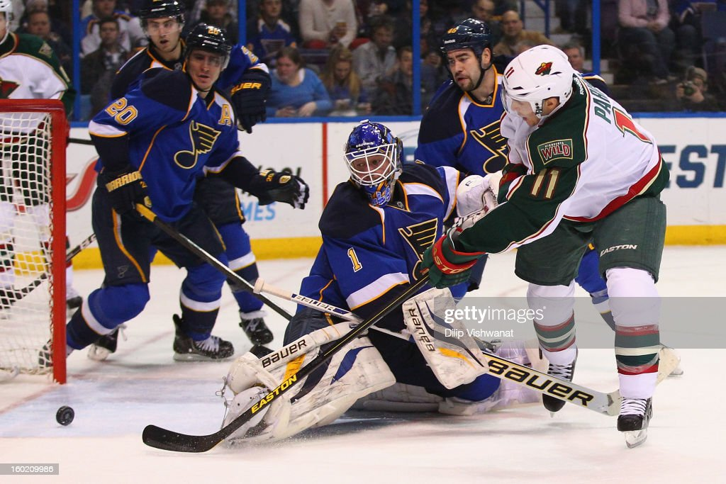 Zach Parise #11 of the Minnesota Wild scores his second goal of the game against Brian Elliott #1 of the St. Louis Blues at the Scottrade Center on January 27, 2013 in St. Louis, Missouri.